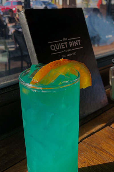 A Blue Hawaiian beverage. An alcoholic mixed drink available at The Quiet Pint.