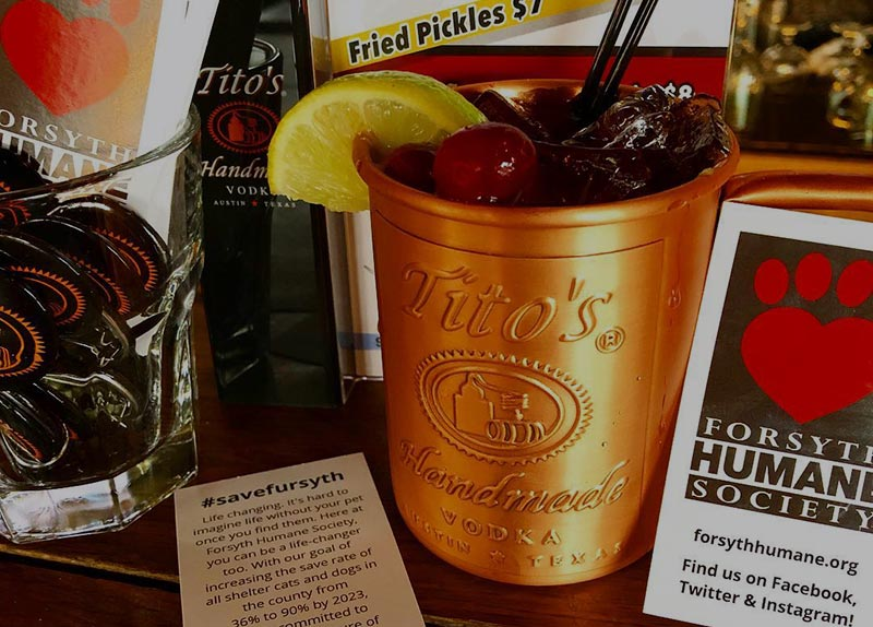Variety of Titos Vodka items and information about the Forsyth Humane Society.